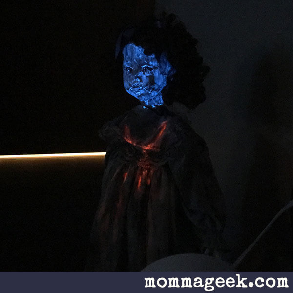 glow in the dark pigment of scary exorcist doll with spinning head.